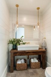 Powder room featuring a salvaged wood console tabl…