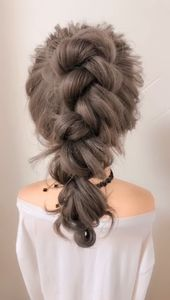 A messy tall ponytail hairstyle