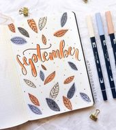 Autumn leaves flying around in the beautiful bullet journal cover by ig@thejourn
