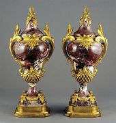 Pair French gilt-bronze mounted rouge marble urns …
