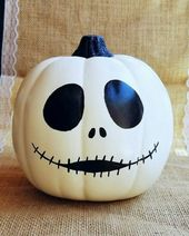 Autumn decoration for Halloween with painted pumpkins