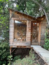 The shed is raised on stilts to match the height o…
