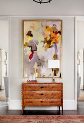 Play Up Vertical Lines By Hanging A Tall Piece On A Narrow Wall
