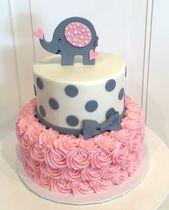 Babypartykuchen mit Elefanten auf die Oberseite. Der Kuchen ist eine rosa Rosette 2 Tier mit …