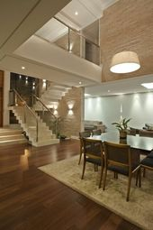 Staircase with glass railing for a chic interior