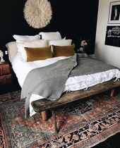 shabby-chic bedroom with white linens, gray blanket, and patterned carpet   – Home