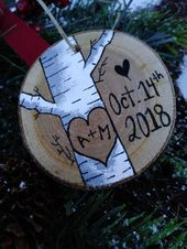 This is a hand painted birch tree ornament on a birch wood slice personalized wi…