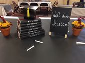 Graduation centerpiece. Use black butcher paper as a runner on top of a white table cloth and leave chalk on the tables for your guests to draw on the...