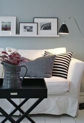 Another example of shelving above couch, really li…