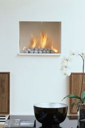 Hole In The Wall Style Fireplace Featuring Platonic S Fire Pebbles