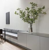 Clean & minimal breakfast nook with built-in bench…