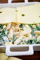 Pasta and spinach casserole topped with plenty of cheese