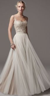 Romantic pearl bodice wedding dress with a light pleated tulle skirt; Feature …