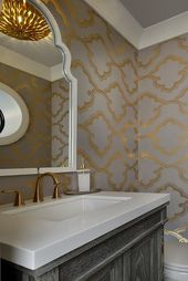Gray and gold powder room boasts walls clad in gra…