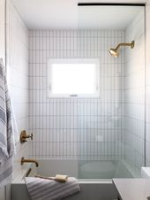 Bathroom design with white vertical subway tiles.