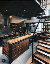 Industrial kitchen with rustic wood elements and thick industrial metal staircase, #elements…