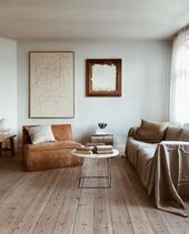 Artwork and Golden Tones in a Lovely Copenhagen Front room with a lightweight blue wal…