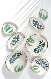 hand painted ceramic serving dishes in various siz…