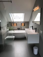 Photo of Simple bathroom layout on the 1st floor and play of colors between gray and white walls
