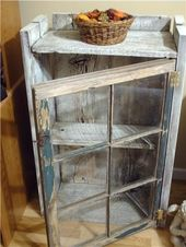 Reuse old windows with old barn wood to build a small cabinet.