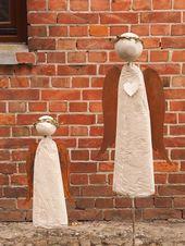 Engel aus Beton mit Rostflügel