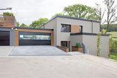 Hybrides und ökologisches einfamilienhaus aus beton und massivholz in mersch (luxemburg) moderne häuser von massive passive modern