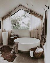 Stunning boho bathroom with oversized circular tub!