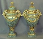 Pair of french empire ormolu mounted marble cassolettes