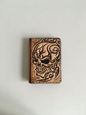 Tooled leather credit card holder, pattern: tribal skull