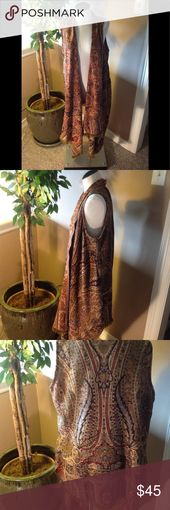 Dilemma New York Earth Tone Fringed Vest, XL Shawl style collar accents this beautifully draped vest that is rich earth tone shades of rust, browns, b...