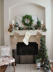 neutral stockings, an evergreen garland with light…