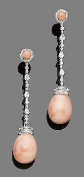 A pair of coral and diamond pendent earrings Each …