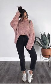Pink chunky knit pullover and black pants with white …