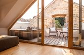 Old stone house roof terrace with jacuzzi