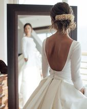 Such a beautiful wedding dress! We love this open-back style. 15896