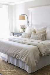 modern farmhouse bedroom design with all white bed…