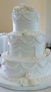 Vintage elegante Hochzeitstorte. Sahneglasur. Wilton. Glasur. Rohrleitungen. Ro …
