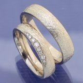 Moonlight wedding rings with hammer blow