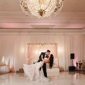Bride and Groom First Kiss in Blush Pink and White Wedding Reception