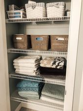 Ideas For Tidying And Organizing A Linen Closet Using Baskets From