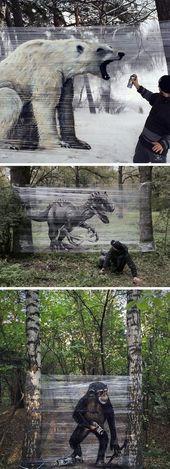 Graffiti-Künstler sprüht riesige Tiere auf Plastikfolie im Wald
