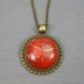 Kintsugi repaired red jasper pendant with an antiqued brass sunflower setting on…   – Products