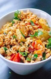 Thai-style sweet and spicy pineapple fried rice with red bell pepper, cashews an…