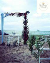 Mariage tropicale cérémonie plage arche voilages,fleurs et feuilles exotiques….