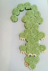 Tick-Tock the alligator from Peter Pan in cupcakes.  The pocket watch is made fr…