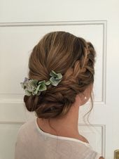 Closed bridal hairstyle with hydrangeas. Side braided