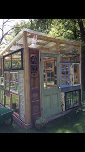 Recycled windows barnwood doors stained glass greenhouse We made after collecti