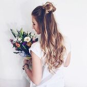 What better way to wear curls than with a half up top knot! Sweet, feminine and trendy #hairspiration