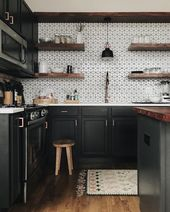 Dark kitchen inspiration with 3D bright white wall tiles for a pop!