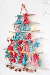 Lybstes. Advent calendar X-Mas driftwood fir tree in red and turquoise
